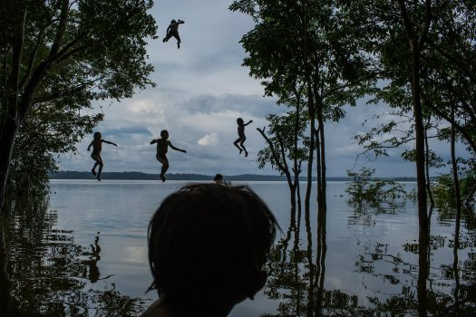 To follow a story on Munduruku indigenous village by Matt Sandy - Indigenous children jump into the water as they play around the TapajÛs river, in the Munduruku tribal area called SawrÈ Muybu, south of Itaituba, Par· state, northern Brazil, on February 10, 2015. CREDIT: Photo by Mauricio Lima for Al Jazeera America
